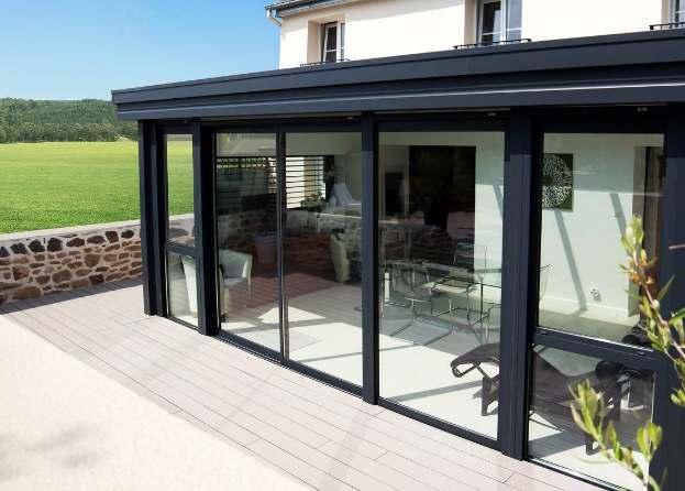 Poele a bois dans veranda simple pole au gaz naturel with for Veranda toit plat bois